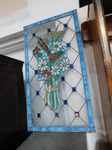 Stained glass floral panel from an ...