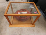 Signed football in glass case...