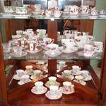 3 SHELVES OF TEA CUPS WITH SAUCERS