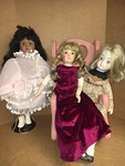 3 BEAUTIFUL PORCELAIN DOLLS AND CHAIR