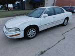 White 4-door 2002 Buick Park Avenue...