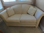 Great light tone loveseat w/pillows...