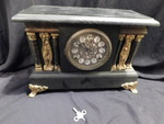 Vintage black mantle clock w/key an...