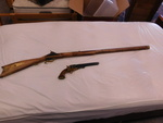 1970 SEARS AND ROEBUCK 45 CALIBER BLACK POWDER RIFLE AND 44 CALIBER PISTOL