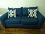Blue tone loveseat w/decorative pil...