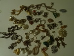 Assorted earrings, pins, necklaces,...