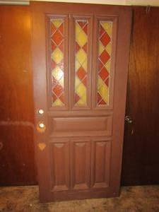 BEAUTIFUL EXTERIOR DOOR WITH STAINED GLASS ACCENTS