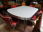Retro style table and 4 red vinyl c...